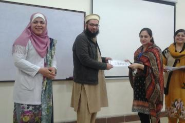 Dr Hamid presenting to Dr Irum1486376724.jpg